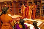 Family of bride choosing fabric for her wedding dress in the Jayalakshmi Silk Emporium in Cochin (Kochi), Kerala