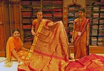 Clerks showing silk fabric to customers in the Jayalakshmi Silk Emporium in Cochin (Kochi), Kerala