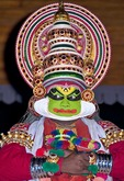 Traditional Kathakali performer with green make-up known as a pacha character in Cochin (Kochi), Kerala