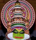 Traditional Kathakali performer, with green make-up known as a pacha character, in Cochin (Kochi), Kerala