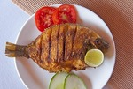 Fried fish lunch on houseboat cruise of the tropical Kerala Backwaters on the Malabar coast of South India.