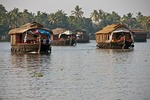Houseboats cruising the tropical Kerala Backwaters on the Malabar coast of South India.