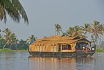 Houseboat cruising the tropical Kerala Backwaters on the Malabar coast of South India.