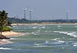 Wind turbines on coast at terminus of Arabian Sea and Bay of Bengal at southern tip of India near Kanyakumari in Tamil Nadu.