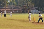 Schoolboys playing cricket in Panaji, Goa.