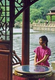 Portrait of Chinese woman in traditional lakeside pavilion in Jiangsu province near Nanjing