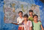 Mayan school girls with mural celebrating their heritage at the La Pintada village primary school at Copan, Honduras.