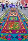 Holy Week (Semana Santa) carpet of colored sawdust (alfombras) in Antigua street prepared for a processional route of a float in the annual religious observance
