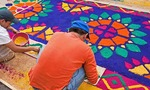 Holy Week (Semana Santa) carpet of colored sawdust (alfombras) being prepared on Antigua street to be a processional route of a float in the annual religious observance
