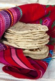Home-made from scratch traditional Maya-style Guatemalan corn tortillas are fluffy and cake-like.