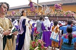 Holy Week (Semana Santa) float in Antigua religious procession with human and statuary observers