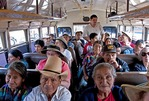 "Guatemalan ""chicken bus"" packed with foreign and local passengers in Antigua."