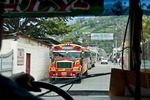 "Riding in a Guatemalan ""chicken bus"" passing two oncoming buses in the town of Santa Catarina Barahona near Antigua."