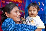 Mayan mother with baby in village near Antigua