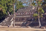 Tourists crossing the Temple of the Inscriptions on the West Court Acropolis of Mayan ruin of Copan