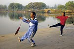 Morning sword exercise (martial art) beside West Lake in Hangzhou