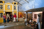 La Azotea Cultural Center's Rincon de Sacatepequez Museum with diorama of customs and costumes in villages around Antigua: a wedding at left and tortilla making at right.