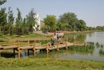 Pond with boardwalk in Sun (Chaoyang) Park in Beijing