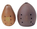 Chinese xun (ocarina-like) vessel flutes made of clay or ceramic; one of oldest Chinese instruments originated from Xun county in Henan province