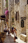 Saint-Paul-de-Vence street with summer strollers
