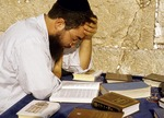 Talmudic student studying texts at Western Wall in Jerusalem