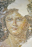 "Detail of Dionysiac mosaic depicting portrait of woman, called ""the Mona Lisa of Zippori,"" from floor of Roman period house in Zippori archaeological site"