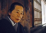 Elderly Japanese woman in traditional clothing at Todaiji Temple in Nara