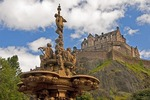 Edinburgh Castle on volcanic castle rock from West Princes Street Gardens with sculpture by Jean-Baptiste Klagmann depicting science, art, poetry & industry on The Ross Fountain