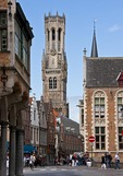 Medieval architecture of Bruges (Brugge) is dominated by the Belfort (belfry tower) as seen from corner of Dijver and Wollestraat in city's historic center