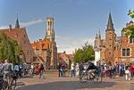 Medieval architecture of Bruges (Brugge) is dominated by the Belfort (belfry tower) as seen along Dijver in city's historic center