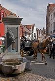 Bruges (Brugge) horse head fountain for watering horses pulling carriages on Wijngaardstraat