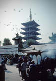 Asakusa Shinto Shrine with pagoda of Senso-ji Buddhist Temple in background in Tokyo