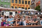 Tourists on Copenhagen canal cruise tour boat in Nyhavn