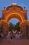 Illuminated entrance at night to Tivoli Gardens amusement park in Copenhagen