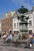 Stork Fountain on Copenhagen's Amagertorv Square is popular meeting place along Stroget pedestrian street