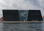 Den Sorte Diamant (The Black Diamond) modern building on Copenhagen's Slotsholmen Island is Royal Library extension designed by Schmidt, Hammer & Lassen architects