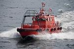 Pilot boat at full speed in Copenhagen harbor on North Sea coast of Denmark
