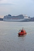 Copenhagen harbor with pilot boat and cruise ship MSC Poesia