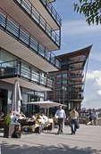 Residential apartment buildings with sidewalk restaurants in Aker Brygge harbor front in Oslo