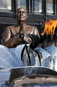 Statue of Sri Chinmoy with The Eternal Peace Flame at Aker Brygge Harbor in Oslo