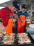 Bergen Fish Market cooks grilling seafood kabobs
