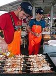 Bergen Fish Market cooks grilling seafood kabobs