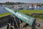 Christiansholm Fortress cannon overlooking Pleasure Boat Harbor at Kristiansand, Norway