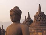 Buddha with stupas on Borobudur Temple, Central Java, Indonesia