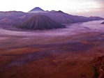 Bromo-Tengger-Semeru National Park viewed at dawn from Mount Penanjakan in East Java, Indonesia, with Mount Bromo crater (left), Mount Batok (rear), and Mount Semeru (front)