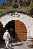 Tourists entering Wine Cave at Gibbston Valley Winery near Queenstown, New Zealand