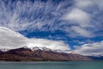 Clouds in early spring over Lake Wakatipu and the mountains near Queenstown, New Zealand.
