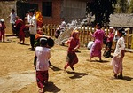 During Water Splashing Festival in Xishuangbanna, children toss buckets of water at the Ba Jiao Tong Buddhist Temple near Jinghong in Yunnan province.