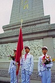 Young Pioneer Honor Guards during national holiday at Monument to the Peoples Heroes in Beijing's Tian An Men Square