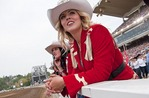 Queen of the Calgary Stampede 2012, Candace Lee, watching Chuckwagon Racing at trackside of the 100th Anniversary annual rodeo.